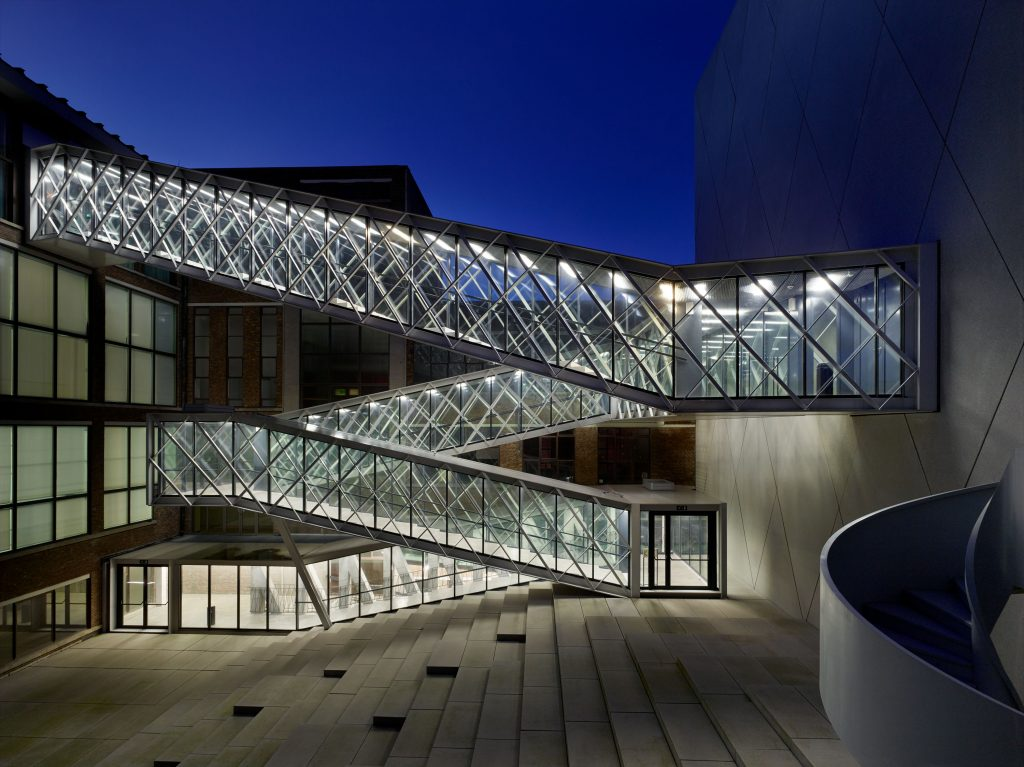 photo by Toon Grobet, patio with steel zigzag outdoor stailrcase at dusk at De Grote Post by B-architects